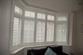 shutter blinds and curtains polywood shutter with side curtains
