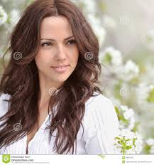spring beauty beautiful young woman in a summer park outdo