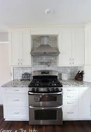 backsplash kitchen photos diy hton carrara polished kitchen backsplash hometalk