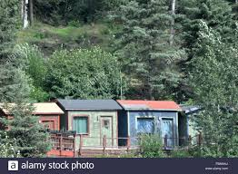 tiny house cabins on a hillside kenai peninsula alaska stock