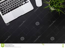 office desk with laptop and plant stock photo image 72909639
