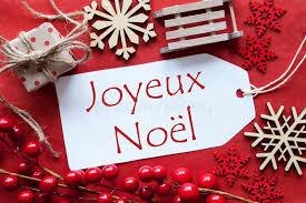label with decoration joyeux noel means merry stock photo