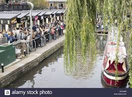 r arer canap view of crowds of shoppers walking around the canal with a and