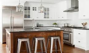 cherry stained kitchen island with black quartz countertops and