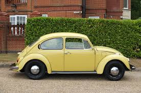 used yellow volkswagen beetle for used volkswagen beetle 1300 yellow 1 3 saloon ashtead surrey