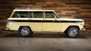 yellow jeep 4 door all american classic cars 1970 jeep wagoneer sj 4wd 4 door suv