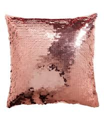 rose gold sequin cushions with satin back add instant interest