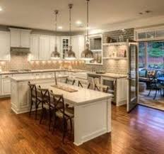 kitchen island and table white shaker waypoint cabinets designed by nathan hoffman if