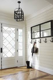 Front Door Chandelier Cottage Entryway With Crown Molding Anchor Wall Hook Glass Panel