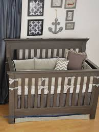 grey and navy houndstooth plaid crib bedding in a nautical nursery