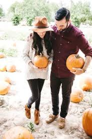 pumpkin patch maternity fall engagement photo ideas hug in a pumpkin patch photo ideas