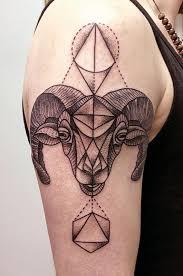 vintage like black ink big goat head tattoo on shoulder stylized