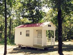 this is a fully furnished custom built tiny house sitting on one