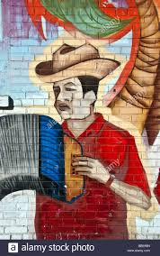 mural on brick stock photos mural on brick stock images alamy detail section depicting an accordionist of a bright somewhat weathered hand painted mural on