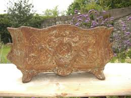 pair of antique french cast iron planters in architectural