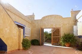 mediterranean style house golden wall mediterranean style house courtyard