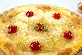 fresh baked pineapple upside down cake with glace cherries stock