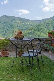 Mountain Outdoor Furniture - garden furniture overlooking mountain scenery stock photo image
