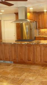kitchen style medium tone wooden paneled cabinet ceramic tile