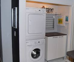 saving small spaces laundry room design using stacked washer dryer
