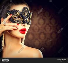 halloween masquerade background beauty model woman wearing venetian masquerade carnival mask at