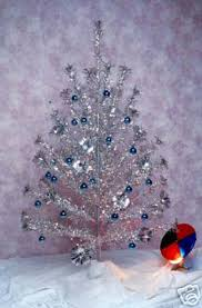 1960 s silver tinsel tree with color wheel ours