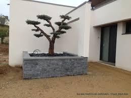 fontaine en pierre naturelle jardinière extérieur en stonepanel ardoise avec couvertine en