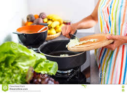 modern vegetarian kitchen young woman cooking in her modern kitchen stock photo image