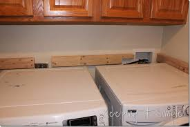 table over washer and dryer door turned into laundry table keeping it simple