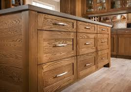 mission style kitchen island shenandoah cabinetry island in oak tawny mission door kitchen