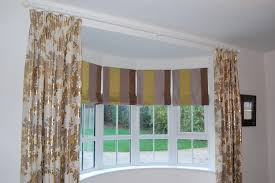 diana murray interiors bow window with roman blinds and dress diana murray interiors bow window with roman blinds and dress curtains diana murray interiors