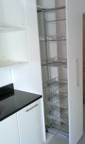 Kitchen Cabinet Pull Out Storage Created By Dimension Cabinets White Melamine Kitchen With Pull