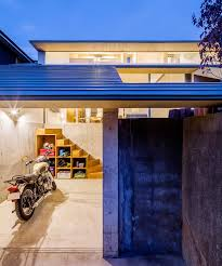dog architect tops house in japan with two tier roof