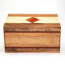 handmade wooden cremation urn in walnut with maple bubinga