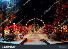 colorfully lighted village square christmas display stock photo
