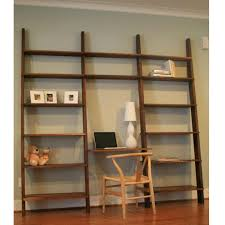 large wooden leaning ladder wall shelves with laptop desk and