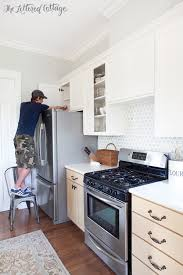 painting the kitchen cabinets kitchen cabinet makeover how to paint cabinets the lettered cottage