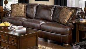 ashley furniture chair and ottoman reverse auction ashley furniture axiom walnut leather sofa