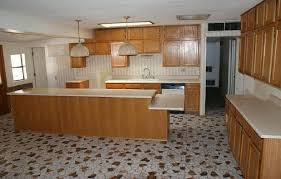 kitchen tile ideas floor flooring ideas white ceramic cups and plates on black granite