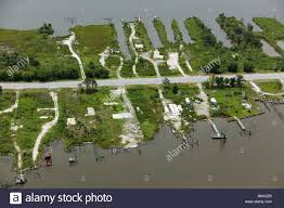 aerial view above empty pads destroyed waterfront homes hurricane