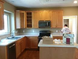 kitchen cabinet color honey glossy white paint on honey oak kitchen cabinets before