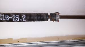 replace spring on garage door how to replace a garage door spring no nonsense landlord