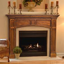 interior rustic cast stone fireplace surround with black wall and