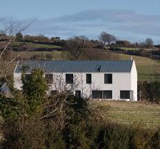 mcgonigle mcgrath u0027s barn like house features pale walls house