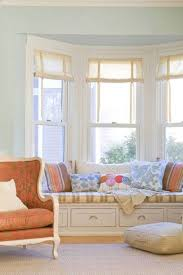 likeable bay window with three panels and white venetian blinds bay window model and engaging pastel blue wall paint color for living room idea with pleasant bench plus cushion also