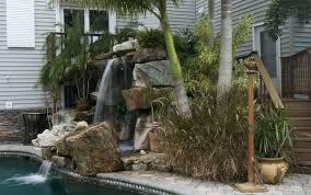 tall grotto waterfall lagoon pool remodel lucas lagoons
