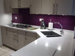 this vibrant violet glass splashback provides the perfect wow