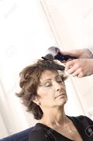 senior woman having haircut in barber shop stock photo picture