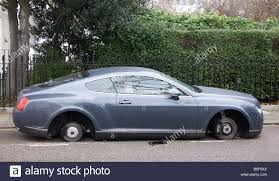 luxury bentley luxury bentley minus its wheels stolen wheels stock photo