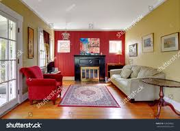 living room red yellow walls fireplace stock photo 128660822